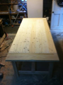 Finished table with breadboards attached. Next step is to stain and seal the whole thing.