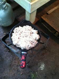 Rendering tallow in a cast iron skillet - outside. It can smell up the kitchen.