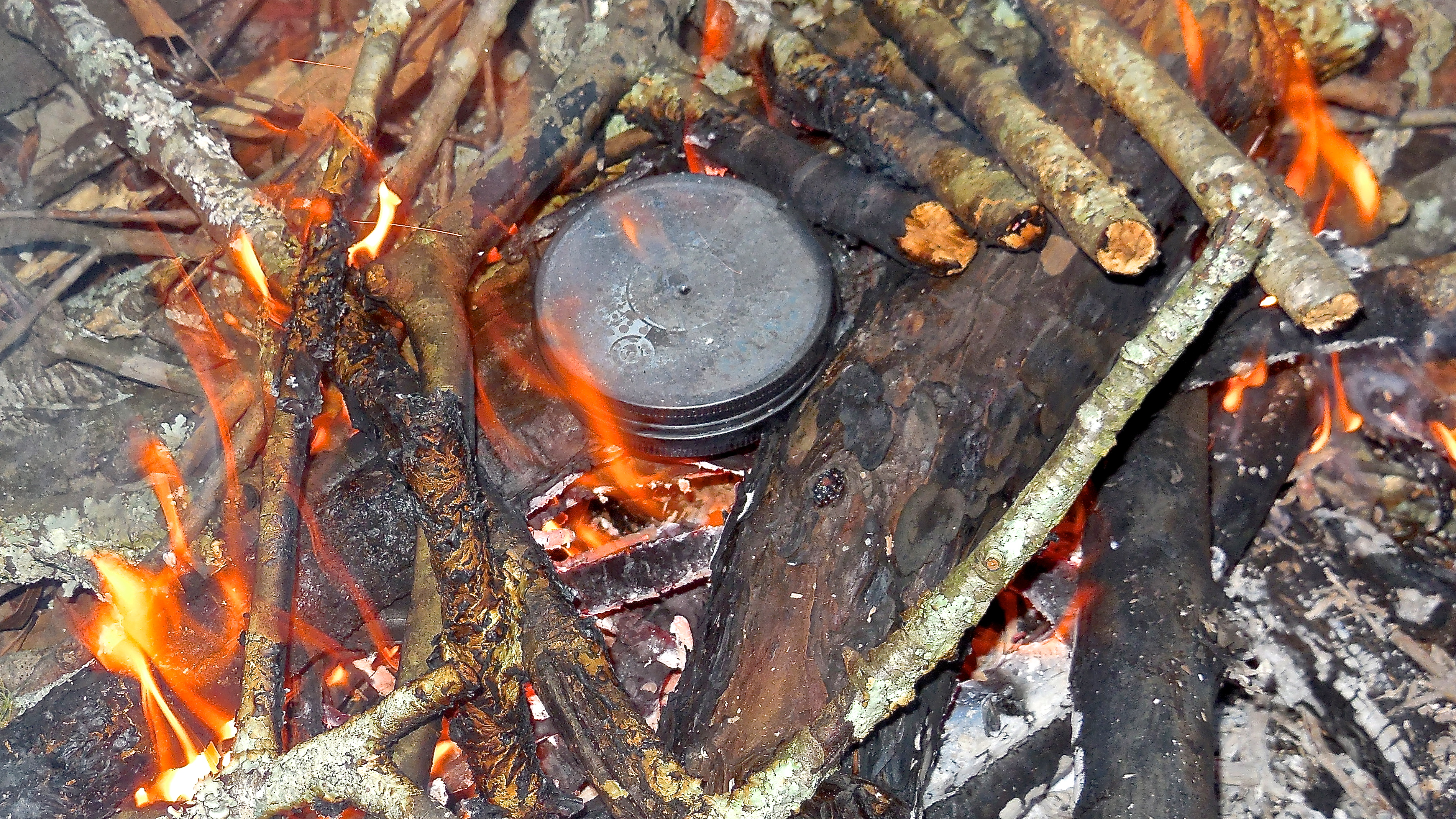 how to start a fire with sticks rubbing together