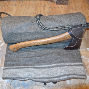 Wool blanket with ax tucked into the roll