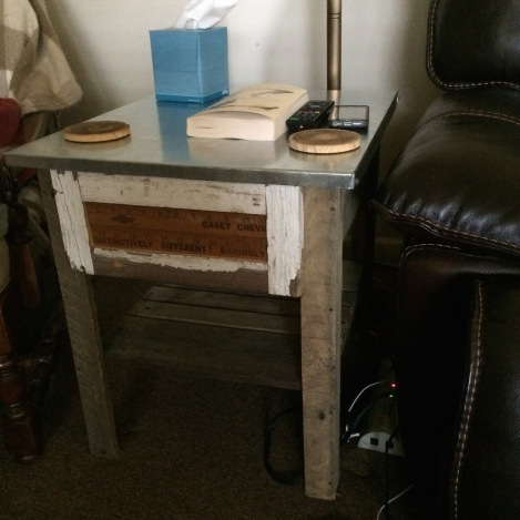 I made this end table for DRG from pallet wood, 150 year-old house siding, an old yard stick, and sheet metal.